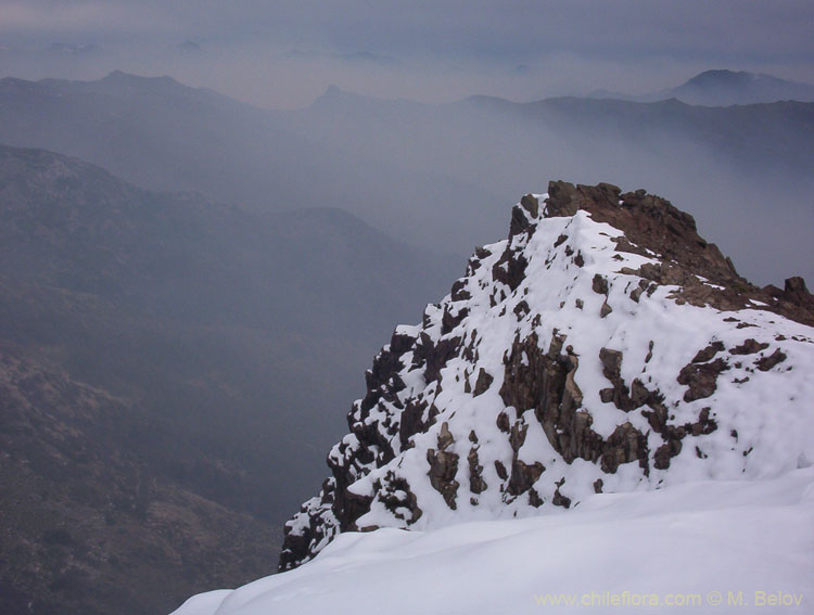 View of a steep peak covered with snow (near Peine), Lircay, Vilches, Chile.