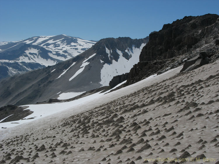 A view of snow-covered slopes near the Las Animas Pass, Mondaca Trail, Radal Siete Tazas, Chile.